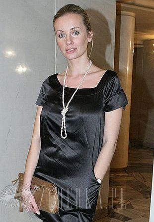 Agnieszka Szulim nosi getry na butach