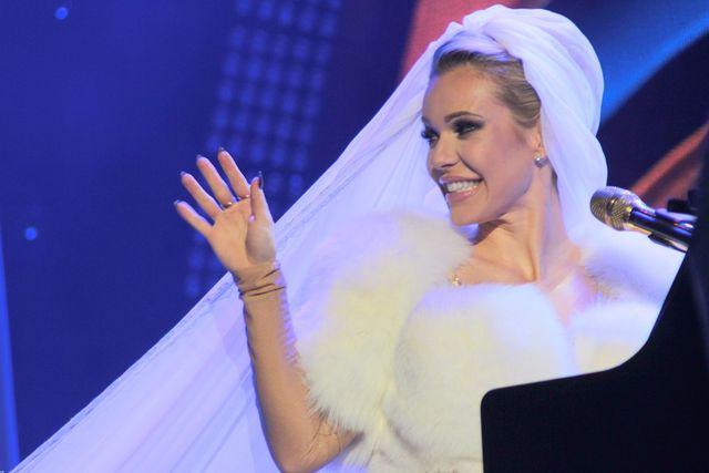 Wiemy, kto z chęcią zaprojektowałby kreację ślubną dla Dody!